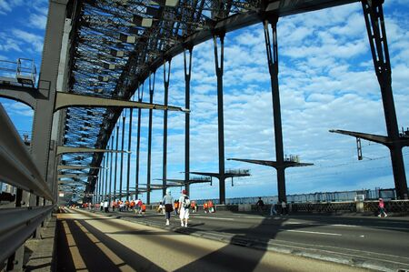 people walking empty harbour bridge on sydney marathon day Stock Photo
