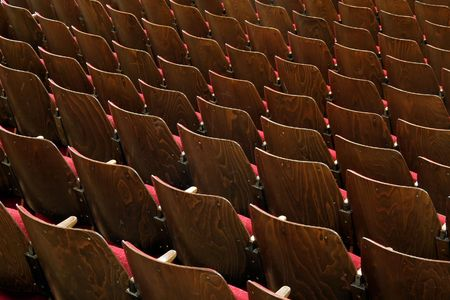 wooden chairs with red fabric, no numbers, theatre scene