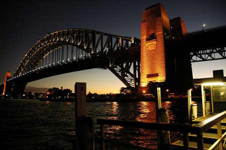 wharf: Harbour Bridge in Sydney; night scene; wooden wharf in foreground Stock Photo