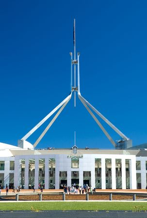canberra: people standing in front of Canberra Parliament House, clear blue sky