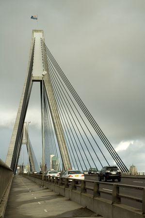 anzac: anzac bridge in sydney, cars in motion, cloudy sky
