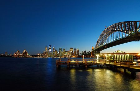sydney harbour bridge: famous sydney landmarks - opera house, harbour bridge, sydney tower, port jackson. color reflections in water Stock Photo
