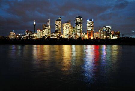 botanic: sydney CBD at night, skyscrapers reflection in water, photo taken from Royal Botanic Gardens Stock Photo