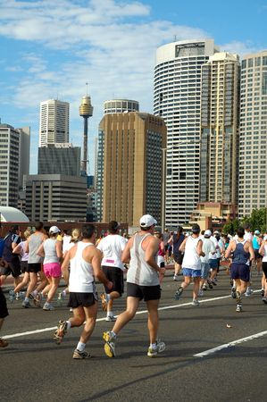 Sydney marathon on harbour bridge, sydney tower in background