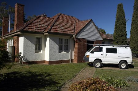 small australian typical house, white van in front of it photo