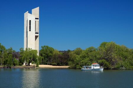 canberra: famous white Carillion in Canberra, lake with boat in foreground Stock Photo