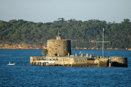 port jackson: island in the middle of port jackson, port denison in sydney, small white ship