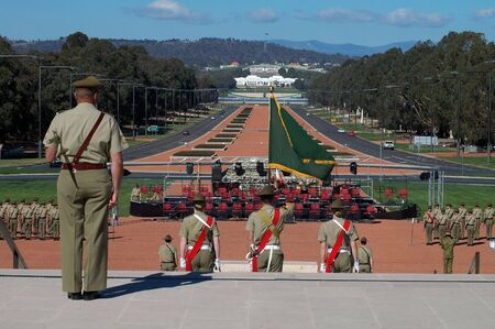 australian soldiers standing in front of australian war museum in Canberra, modern Parliament House in background, Anzac Parade