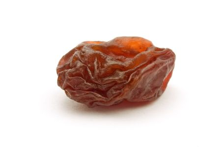 dried brown raisin isolated on white background