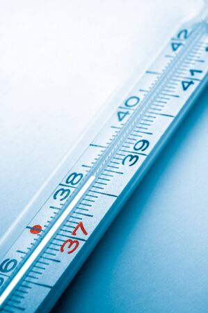 colored clinical thermometer detail, hight temperature, cyan background Stock Photo - 3234760
