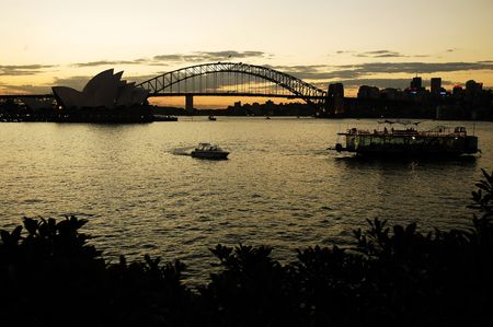 opera  and harbour bridge, boats in foreground, dusk
