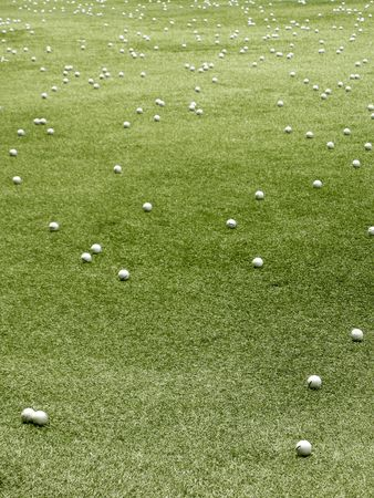 several white golf balls on short cut grass photo