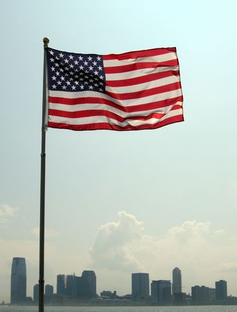 united states of america nation flag, jersey city in background