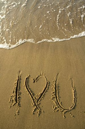 I love you written in sand on a beach, ocean water photo