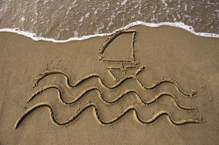 waves and a small sail boat written in sand on a beach, wave approaching