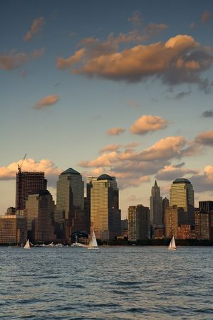 manhattan mirror new york: Buildings at the World Financial Center, dusk scene, Hudson river in foreground Stock Photo