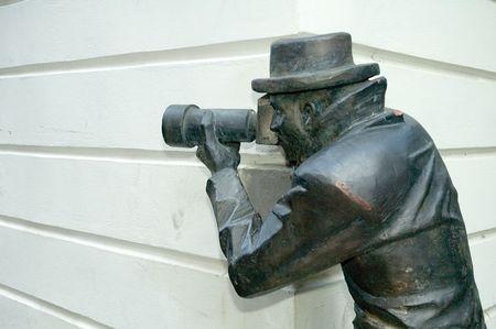 famous paparazo sculpture in historic part of bratislava
