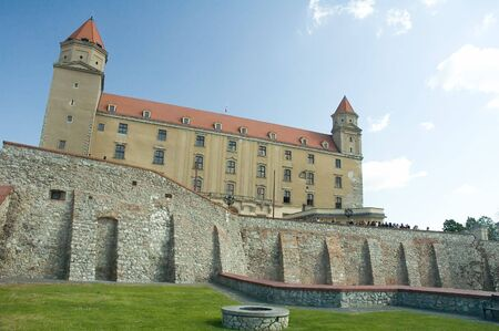 slovak: photo of bratislava castle, well in foreground
