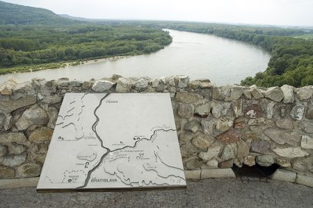 view from famous landmark - devin castle, river donau dividing slovakia and austria, map in foreground photo