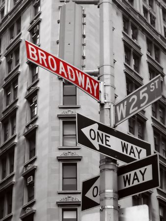 red broadway sign in a black and white photo of new york city signs Stock Photo