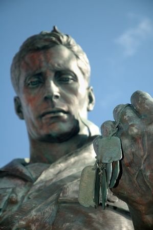 statue soldier holding his army marks detail photo, distance blur photo