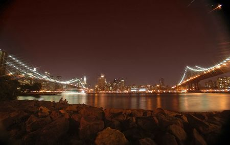 bring: brooklyn and manhattan bridge night photo, rocks in foreground, star filter used to bring up the lights
