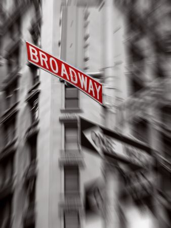broadway tower: red broadway sign, black and white photo, zoom blur