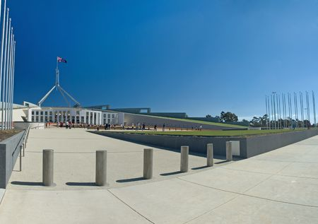 Parliament House in Canberra, visitors in distance, clear blue sky Stock Photo