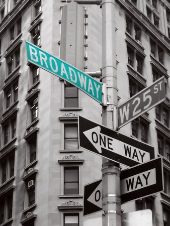 new direction: green broadway sign in a black and white abstract photo