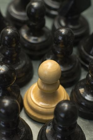 excluded: white pawn in the middle of black pawns, conceptual theme