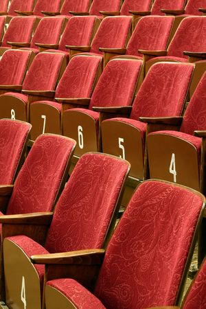 Red cinema or theatre seats, white numbers on wooden part Stock Photo - 4661104