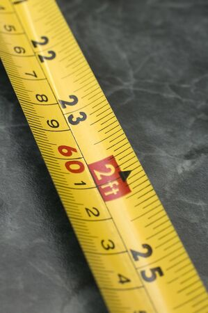 yellow Measuring Tape in centimeters and feets, distance blur, marble background Stock Photo - 4661053