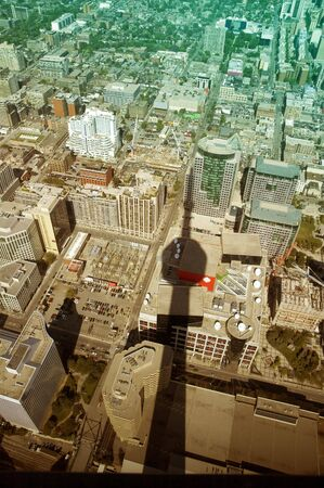 colored picture of toronto buildings with cn tower shadow, photo