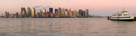 pink panorama photo of lower Manhattan, New York, USA, white ship in foreground photo