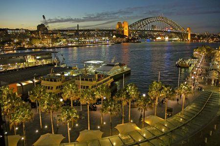 Circular Quay in Sydney, night photo, harbour bridge in background photo