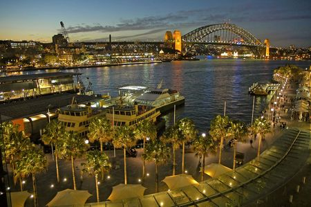 quayside: Circular Quay in Sydney, night photo, harbour bridge in background