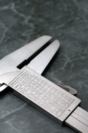 Precision measurement tool made of steel, inches and millimeter, detail photo photo