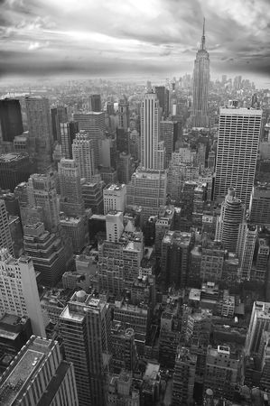 New York black and white vertical photo, Empire State Building visible in distance Stock Photo