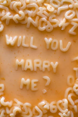 Will you marry me text made of pasta letters, ketchup tomato soup Stock Photo - 4966330