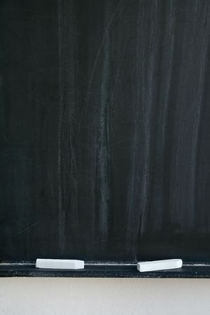 white chalks: blackboard with two white chalks, detail photo Stock Photo