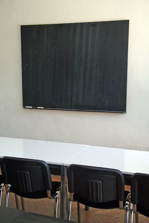 empty blackboard, blck chairs, white table Stock Photo - 4993543