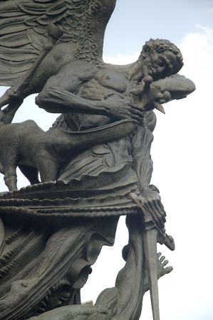 detail photo of Peace Fountain next to Cathedral of Saint John the Divine, Manhattan, New York, USA. This controversial sculpture depicts the struggle between good and evil. photo