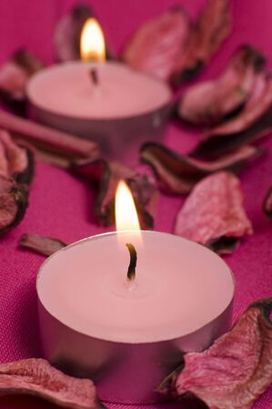pink candles on violette decorated cloth,  Stock Photo - 5023192