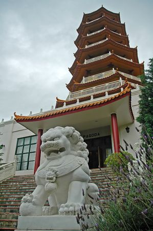 Pagoda and a dragon-dog sculpture in Nan Tien Temple complex, Sydney, Australia Stock Photo - 5023252