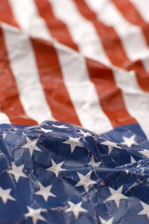 wrinkled paper USA flag, shallow depth of view, vertical photo