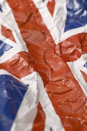 wrinkled paper flag of United Kingdom, shallow depth of view, vertical photo photo