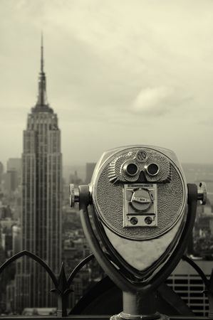 black and white manhattan photo, steel binoculars in foreground, empire state in background