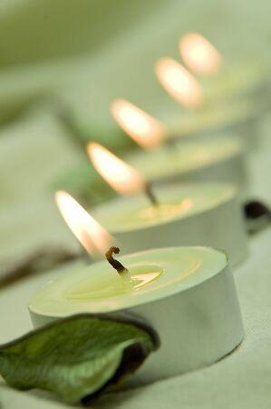 lit: vertical photo of green candle lights