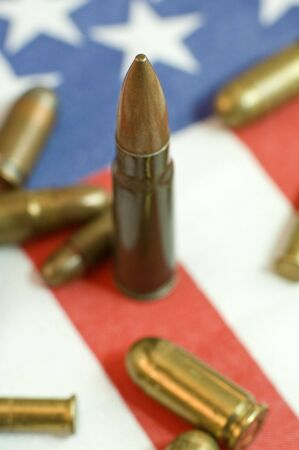 several bullets on USA flag, shallow depth of view photo