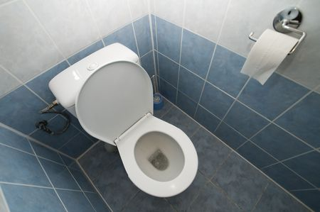 clean open toilet photo, tiled walls and floor